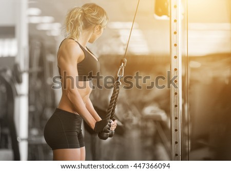 Muscular fitness woman doing exercises.Concept of healthy lifestyle.  - stock photo