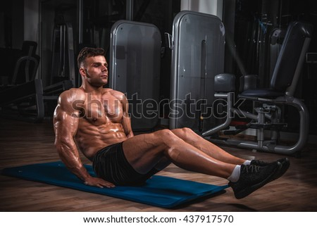 Muscular handsome man exercise in he gym. - stock photo