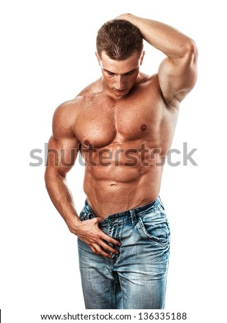 Muscular handsome sexy guy posing, isolated on white - stock photo
