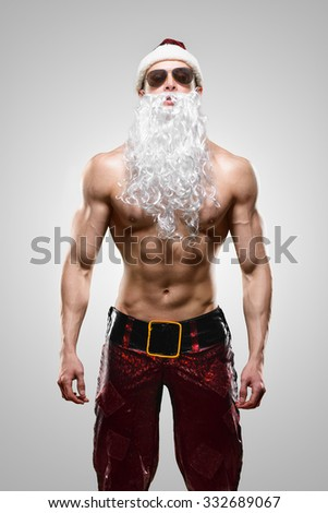Muscular handsome sexy Santa Claus