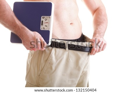 Muscular male body and scale isolated on white background - stock photo