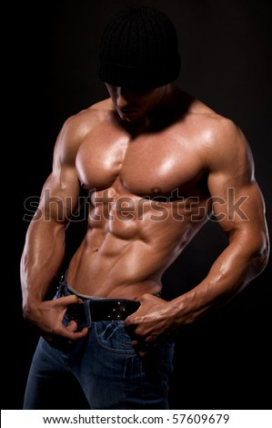 Muscular male body  on black background.