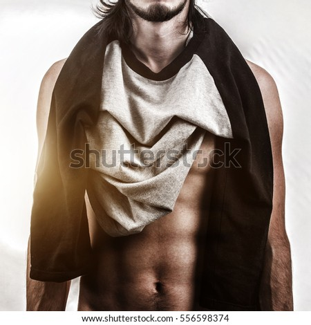 Muscular male body on white bacjground. Fashion