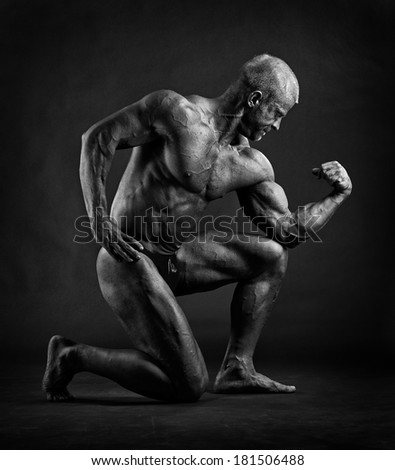 Muscular male bodybuilder posing in studio - stock photo