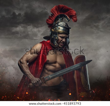 Muscular male in spartan costume holding sword and shield under stormy sky.