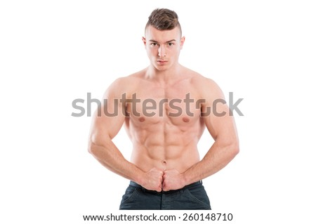 Muscular male model flexing abs and arms isolated on white background - stock photo