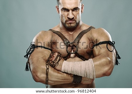 muscular male portrait of ancient warrior - stock photo