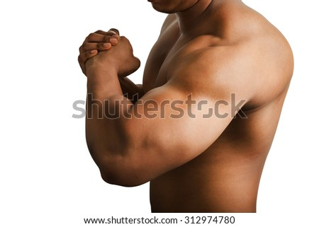 Muscular male showing big arm muscles isolated on white background. - stock photo
