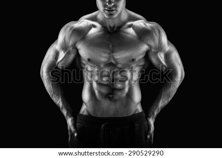 Muscular male torso. Perfect fit, six pack, abs, shoulders, deltoids, biceps, triceps and chest. Black and white image - stock photo