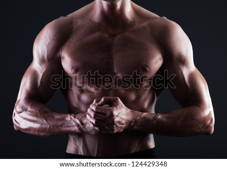 Muscular male torso with lights showing muscle detail isolated - stock photo
