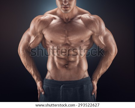 Muscular male torso. Young athletic man with great physique. Perfect fit, six pack, abs, shoulders, deltoids, biceps, triceps and chest.