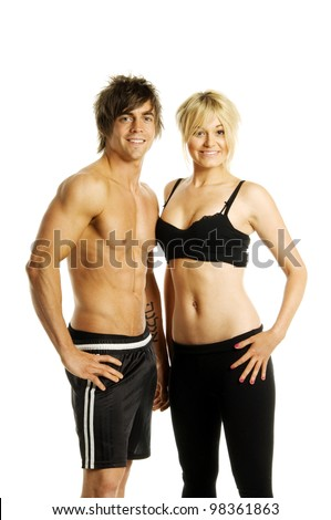 Muscular man and pretty blonde woman in athletic gym wear