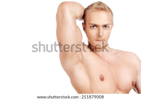 Muscular man bodybuilder demonstrating his perfect muscular body - muscles of the chest and arms. Isolated over white background.
