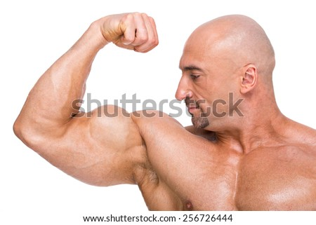 Muscular man bodybuilder. Man is posing on a white background, shows his muscles. Concept of bodybuilding. - stock photo