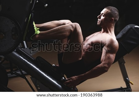 Muscular Man Calves - Bodybuilders Legs Shot In A Gym In Workout  - stock photo