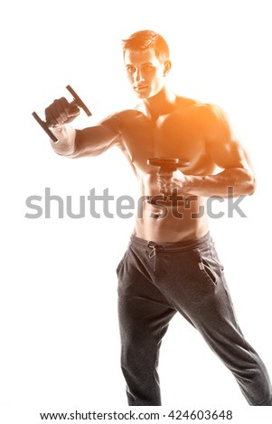 Muscular man doing exercises with dumbbells isolated on white background - stock photo