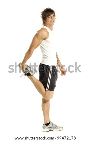 Muscular man doing stretching exercises isolated on a white background - stock photo