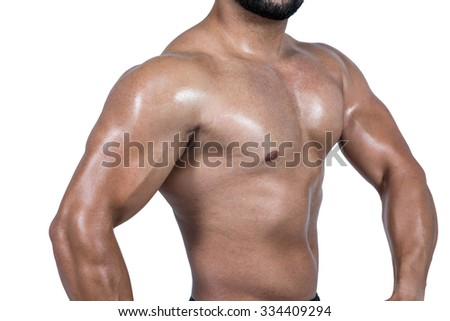 Muscular man flexing his biceps on white background - stock photo