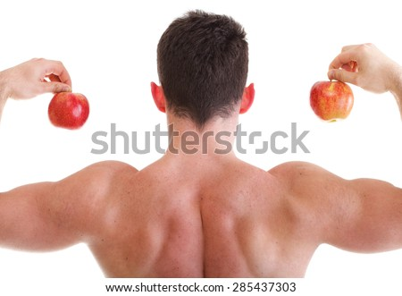 Muscular Man holding red apples back view isolated on white. Athletic sexy male body builder with fruits