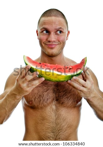 Muscular man holding watermelon. Isolated on white