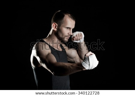 muscular man, hour boxer, black background, horizontally - stock photo