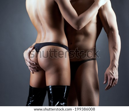 Muscular man hugging elastic female ass