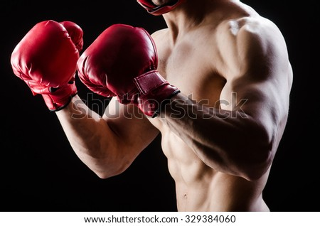 Muscular man in boxing concept - stock photo