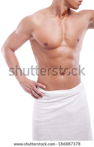 Muscular man in towel, isolated on white - stock photo