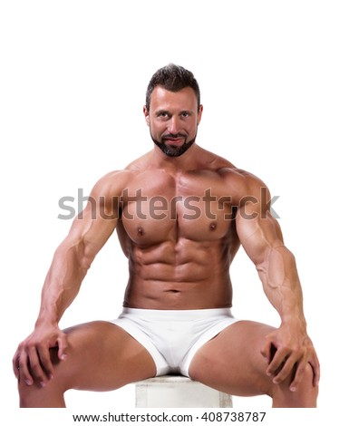 Muscular man in underwear isolated on white