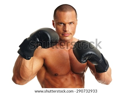 Muscular man in with boxer gloves on white background