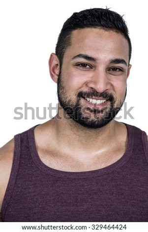 Muscular man looking at camera on white background