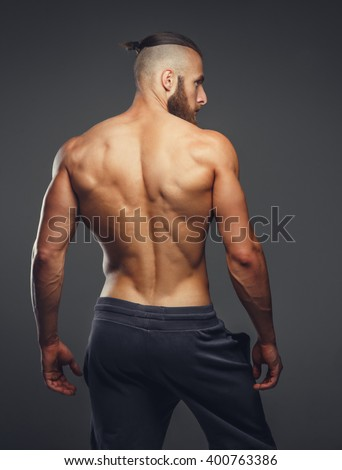 muscular mans back on grey background stock photo edit now