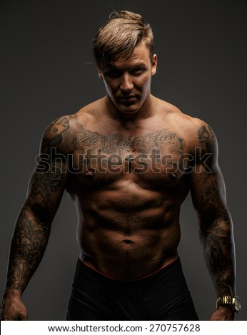 Muscular man showing his great body. Isolated on grey - stock photo