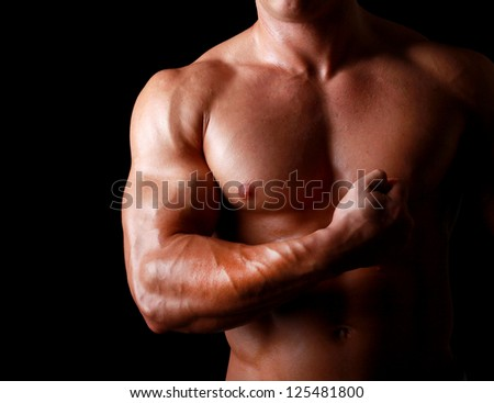 Muscular man showing his strong biceps - stock photo