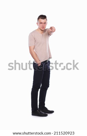 Muscular man showing you, isolated on white background