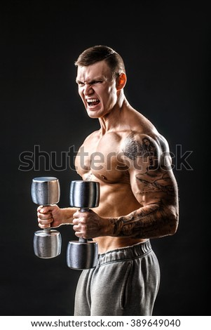Muscular man. side view. black background - stock photo