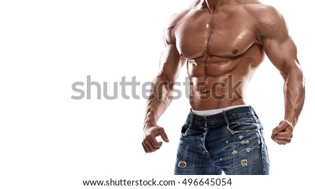 Muscular man wearing jeans on white background