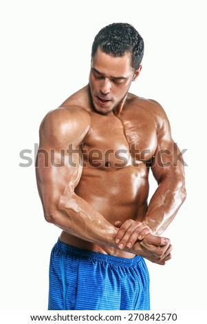 Muscular man with naked torso on white background - stock photo