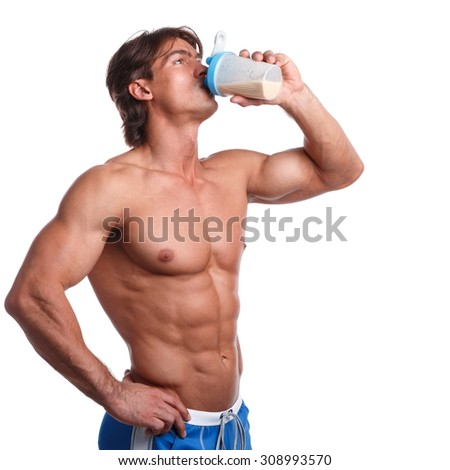 Muscular man with protein drink in shaker over white background - stock photo