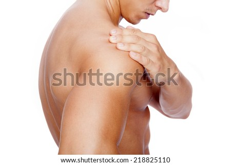 Muscular man with shoulder pain, isolated on white background - stock photo