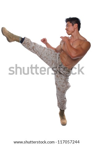Muscular Marine high kick in Uniform isolated on white - stock photo