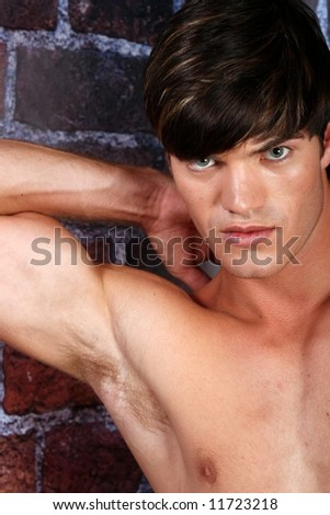Muscular model on a brick background