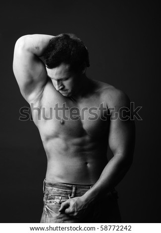 muscular model posing in studio -black and white photo - stock photo