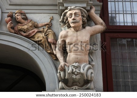 Muscular mustached atlas supported a Renaissance house in Gdansk, Poland.