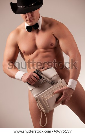 Muscular naked male stripper with ladie purse - stock photo
