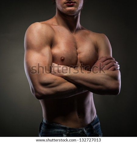 Muscular naked man on black