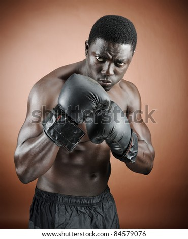 Muscular serious looking boxer training - stock photo