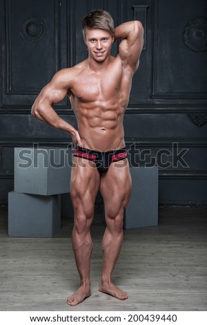 Muscular sexy young naked smiling guy posing in underwear - stock photo