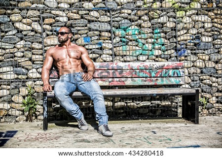 Muscular Shirtless Hunk Man Outdoor in City - stock photo