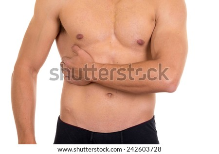 muscular shirtless man with right abdomen pain isolated on white - stock photo